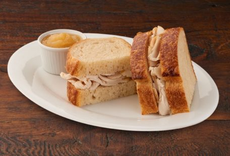 Kids turkey sandwich on sourdough with applesauce