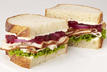 Turkey Cranberry Sandwich with, red onion, lettuce and mayo on sliced sourdough