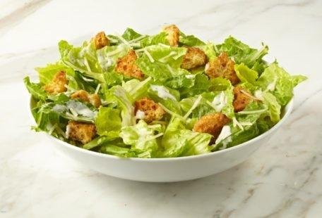 Caesar Salad with sourdough croutons and Parmesan cheese in a bowl