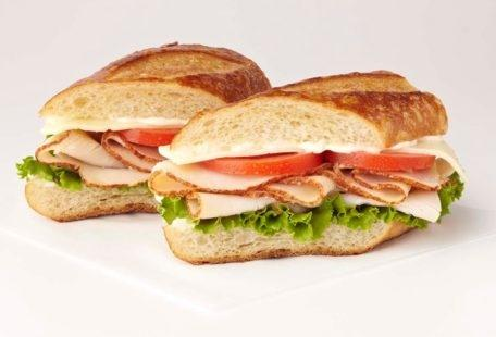 Turkey Havarti Sandwich with tomatoes, lettuce and mayo on a sourdough baguette
