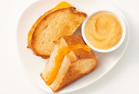 Kids grilled cheese sandwich on sourdough with applesauce