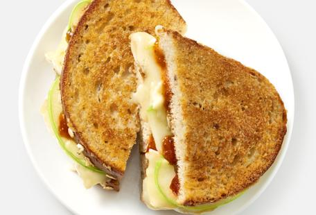 Grilled Brie with apples and fig jam on Parmesan-crusted multigrain bread