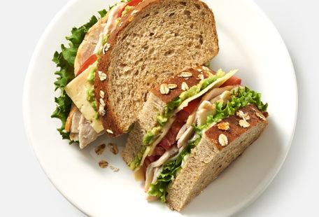 Turkey Avocado Sandwich with Havarti, tomatoes, lettuce and mayo on multigrain bread