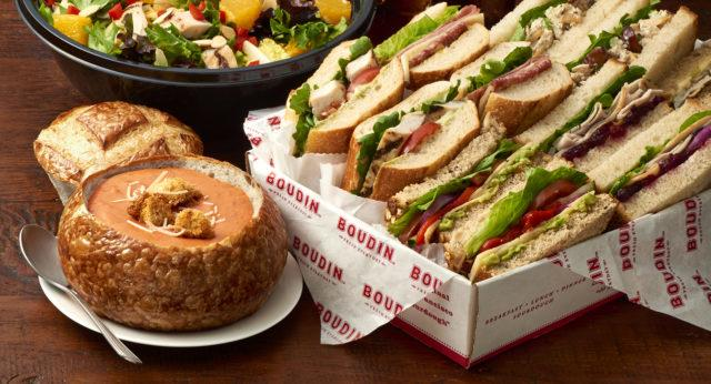 Catering sandwich assortment, tomato soup in a bread bowl, Asian chicken salad and desserts